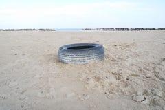 Wheel on the sand Stock Photo