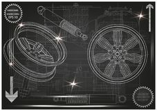 Wheel and shock absorber on a black. Background Stock Photography