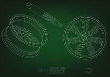 Wheel and shock absorber on a green. Background Royalty Free Stock Photos