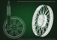 Wheel and shock absorber on a green. Background Stock Images