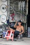 Wheel shop, Ho Chi Minh City, Vietnam. Man selling bicyle parts, Ho Chi Minh City, Vietnam Stock Photography