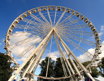 Wheel in the Sky. Mobile Ferris Wheel against a deep blue Summer Sky Stock Photography