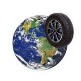 Wheel sliding on globe Stock Photography