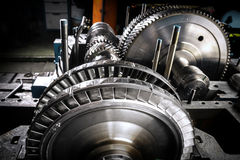 A wheel of a small steam turbine. Metal gear. Gear wheel of the engine Stock Photo