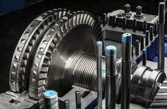 A wheel of a small steam turbine. Metal gear. Gear wheel of the engine Stock Photos