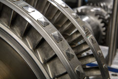 A wheel of a small steam turbine. Metal gear. Gear wheel of the engine Royalty Free Stock Photo