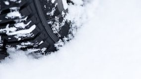 Wheel in the snow, close up. Reliable winter tires - the passengers safety.  stock photography