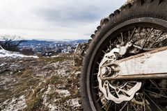 Wheel with spokes and brake disc plus Enduro motorcycle chain. Royalty Free Stock Images