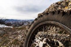 Wheel with spokes and brake disc plus Enduro motorcycle chain. Royalty Free Stock Image