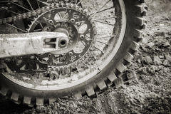 Wheel of sport bike on dirty motocross road Stock Photography