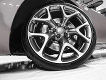 Wheel of sports car. Wheel of new  sports car close up Stock Photography