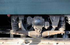 Wheel and springs of a locomotive close up stock image