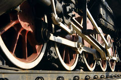Wheel steam train. Red wheels of old steam train with connecting rod Royalty Free Stock Images