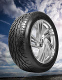 Wheel with steel rim over cloudy sky stock images