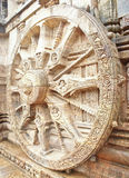 The wheel of Sun God's chariot at Konark Temple. The 13th century mythical wheel of Sun God's chariot carved on one of the walls of Sun Temple at Konark located Stock Photos