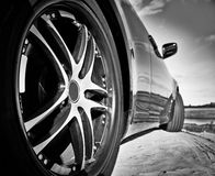 Wheel super car. Racing on the sand. Royalty Free Stock Photos