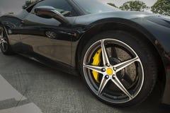 Wheel of supercar. Wheel hub details of the black supercar royalty free stock image