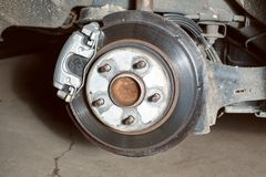 Wheel suspension visible during  tire change. Wheel suspension visible during tire change close up Stock Photography