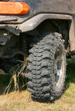 Wheel SUV. Muddy wheel close-up on a vehicle participating in off-road challenge Stock Photo