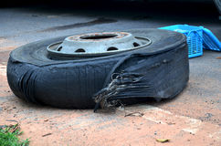 Wheel tire of bus broken and explosion on the road Stock Image