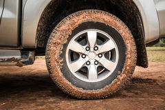 Wheel tire mess up with mud Royalty Free Stock Photography