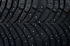 Wheel tire seamless pattern. A close up of a tire protector and studs. Winter tyre texture. Realistic illustration. Black rubber,. Studs and protector stock photos