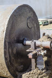 Wheel to press mud to made mud bricks. For architectural work stock images