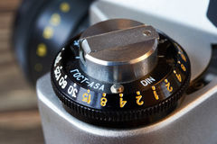 Wheel to set control sensitivity to retro SLR camera Stock Photos