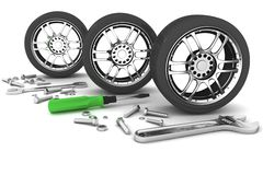 Wheel and Tools. Car service. Royalty Free Stock Images