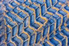 Wheel track. On gravel soils with vivid blue color tone Royalty Free Stock Photo