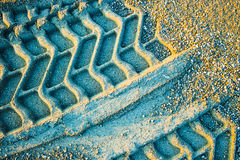 Wheel track. On gravel soils with vivid blue color tone Stock Image