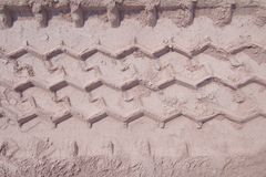 Wheel track running through the sand, used as background Stock Photography