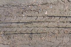 Wheel track on soil ground with small sand stone for industrial construction concept design.  Stock Images