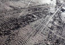 Wheel tracks on the dirt road Royalty Free Stock Photos