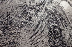 Wheel tracks on the dirt road Stock Photography