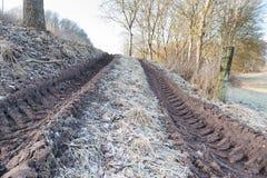 Wheel tracks on muddy ground Stock Photo