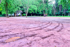 Wheel tracks in outdoor carpark after raining Stock Image