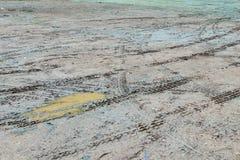 Wheel tracks in outdoor carpark after raining Royalty Free Stock Photos