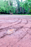Wheel tracks in outdoor carpark after raining Royalty Free Stock Photo