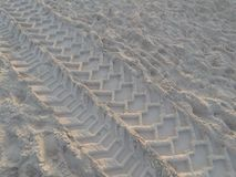 Wheel tracks over the sand royalty free stock photo