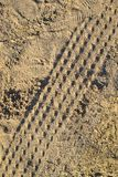 Wheel tracks on sand ground texture. Background Stock Image