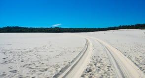 Wheel tracks on sand royalty free stock photography