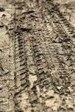Wheel tracks on the soil. Royalty Free Stock Photos