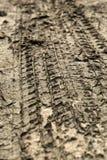 Wheel tracks on the soil. Royalty Free Stock Photos
