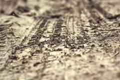 Wheel tracks on the soil. Stock Images
