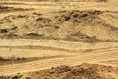 Wheel tracks on the soil. Stock Photos