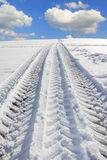 Wheel tracks from a truck tire in winter Royalty Free Stock Photography