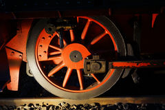 Wheel of train. Red train wheel with light and shadow Royalty Free Stock Photos