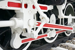 Wheel of train with white and red mechanism Stock Photo