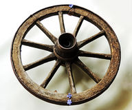 Wheel from the trolley. Wooden old with iron rusty rim. stock image